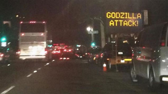 image of hacked road sign which says 'godzilla attack!'
